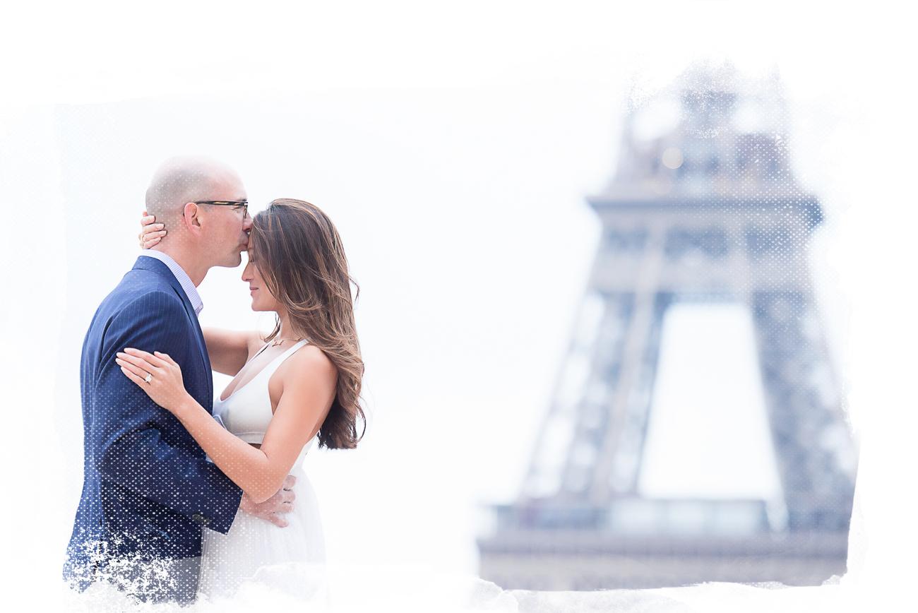 couple kiss eiffel tower