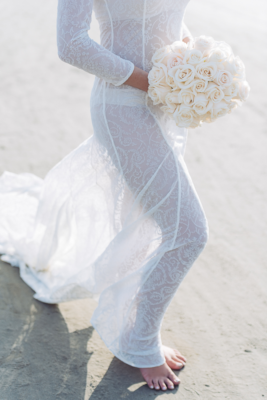 bride-in-cartagena-beach-with-flowers-55