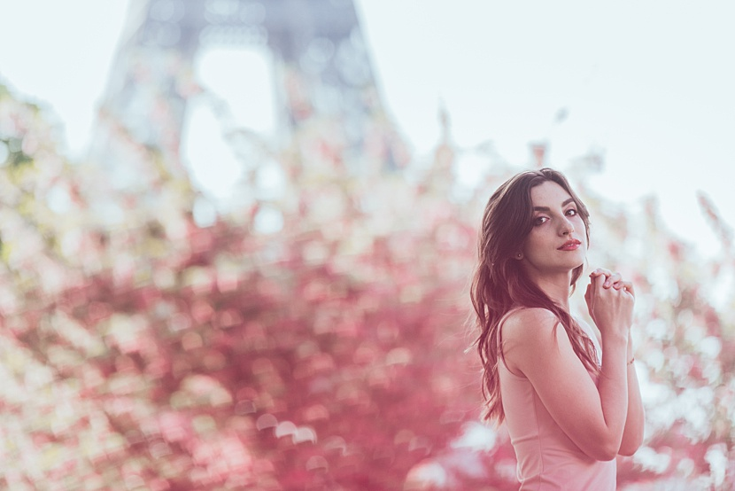 sexy Paris portrait of a woman in front of the Eiffel Tower during her boudoir photoshoot by gloria villa